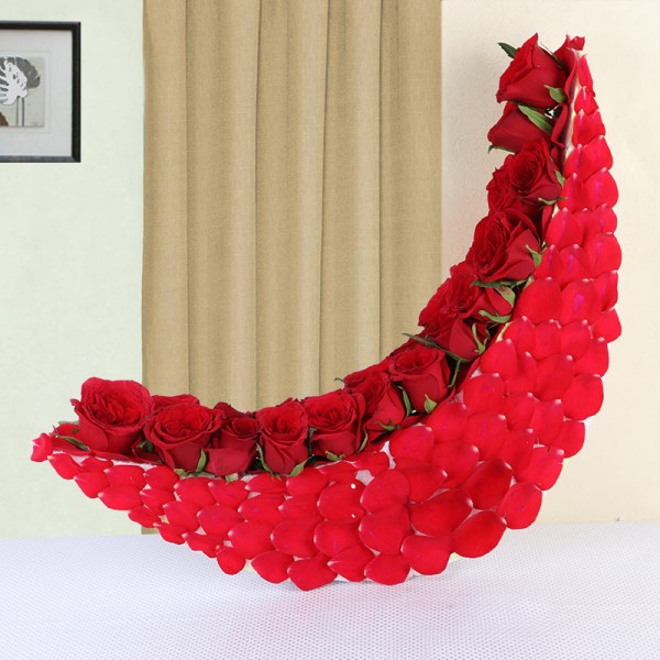 Moon-shaped arrangement of 25 Red Roses and Rose Petals