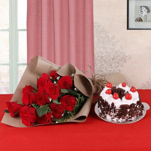 12 Red Roses in Brown Paper with Black Forest Cake (Half Kg)