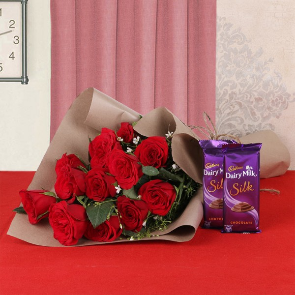 12 Red Roses in Brown Paper, Jute Thread with 2 Cadbury Silk Chocolates (60gms each)