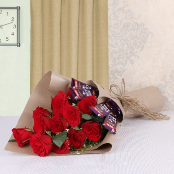 Arrangement of 12 Red Roses and 4 Dairy Milk Chocolates (13gms each)