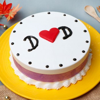 "Half Kg Butterscotch Cake with "" DAD"" written on it"