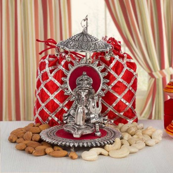 Silver plated Ganesha with Dryfruit Potlis