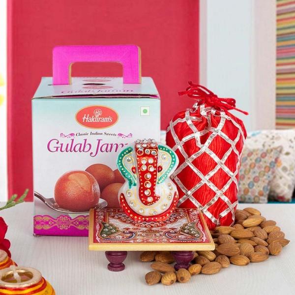 Gulab Jamun with Almond and Marble Charpai Ganesha
