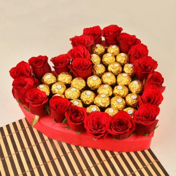 Heart Shaped arrangement of 20 red roses with Ferrero Rocher Chocolate (24 pcs)
