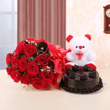 12 Red Roses in Red Paper and Red Bow with Truffle Cake (Half Kg) and 1 Teddy Bear (6inches)