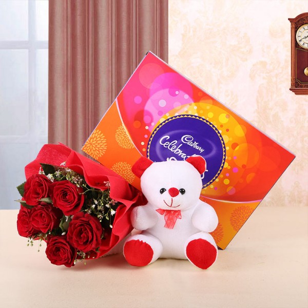 6 Red Roses in Red Paper and Red Bow with Teddy Bear (6 inches) and 1 Cadbury's Celebrations (131.6 gms)