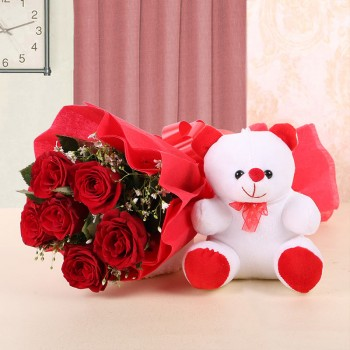 6 Red Roses wrapped in a Red paper and a Red bow with 1 Teddy Bear (6 Inches)