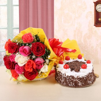 12 Assorted Roses in Yellow Paper and Red Bow with Black Forest Cake (Half Kg)