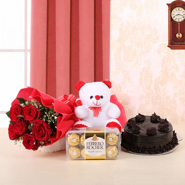 6 Red Roses in Red Paper, Red Bow with Truffle Cake (Half Kg), 1 Teddy Bear (6inches) and Ferrero Rocher (16pcs)