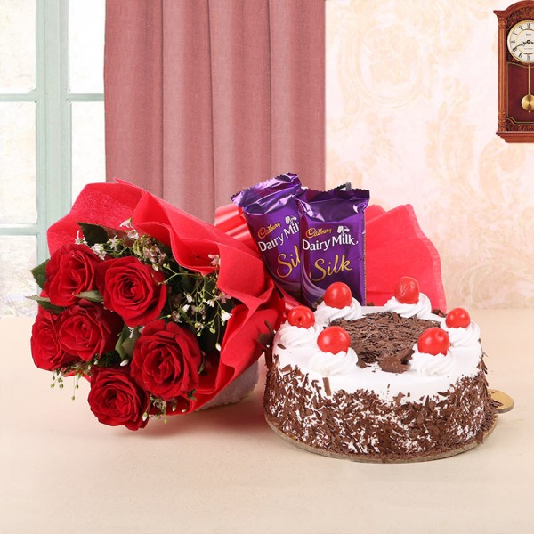 6 Red Roses in Red Paper and Red Bow with Black Forest Cake (Half Kg) and 2 Cadbury's Dairy Milk Silk (60gms each)