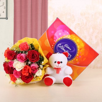 12 Assorted Roses in Yellow Paper with 1 Teddy Bear (6 inches) and Cadbury's Celebrations (131.3gms)