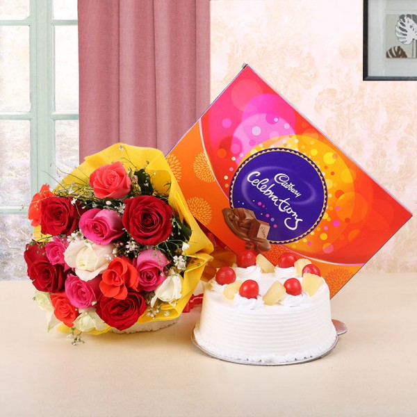 12 Assorted Roses in Yellow Paper  with Pineapple Cake (Half Kg) and Cadbury's Celebrations (131.3gms)