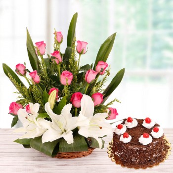 Floral Basket Arrangement with 15 Pink Roses and 2 White Asiatic Lilies and Half Kg Black Forest Cake