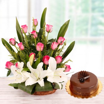 Floral Basket Arrangement of 15 Pink Roses and 2 White Asiatic Lilies with Half Kg Chocolate Cake