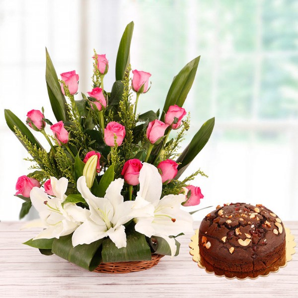 Floral Basket Arrangement in 15 Pink Roses and 2 White Asiatic Lilies with Half Kg Plum Cake