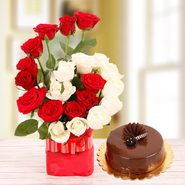 22 Roses( Red and White) in a Glass Vase with Half Kg Chocolate Cake