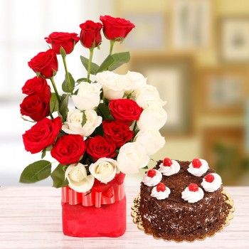 22 Roses( Red and White ) in a Glass Vase with Half Kg Black Forest Cake