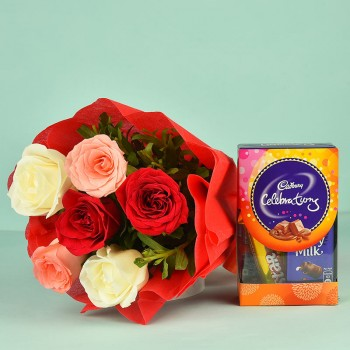 6 Assorted Roses in a paper packing with Celebration Pack ( 65 gm)