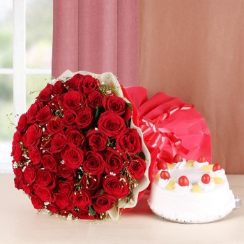 50 Red Roses with Pineapple Cake (Half Kg) and Red and White Paper