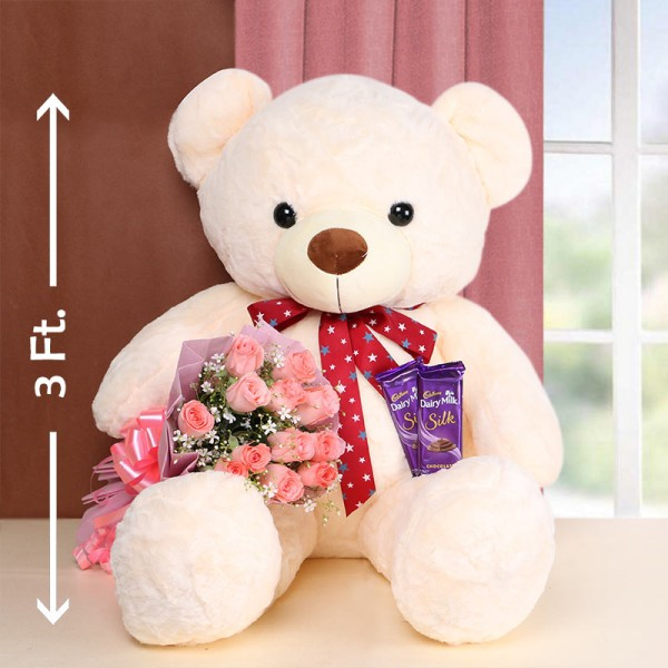 12 Pink Roses in Pink Paper with 2 Cadbury Silk Chocolates 60gms and Teddy Bear 3ft.