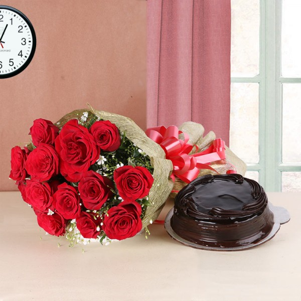 12 Red Roses in Golden Paper with Truffle Cake (Half Kg)