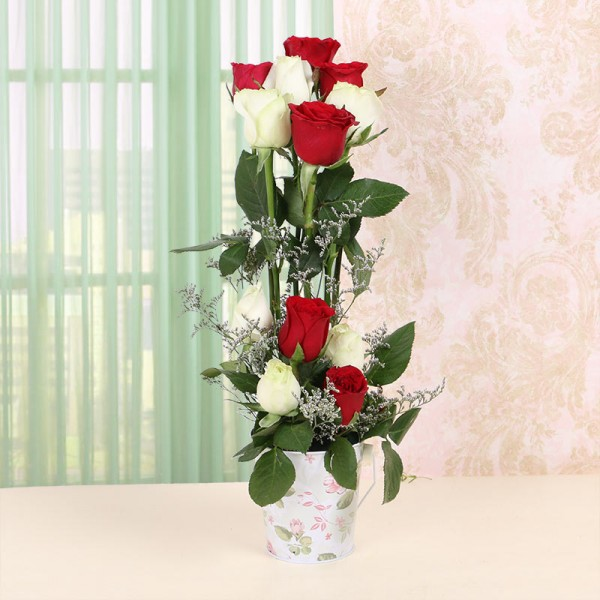 Floral arrangement of 12 Red and White Roses in 1 Tin Bucket