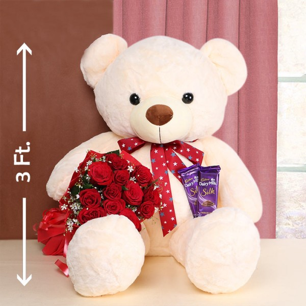 12 Red Roses in Red Paper with 2 Cadbury Silk Chocolates 60gms and Teddy Bear 3ft.