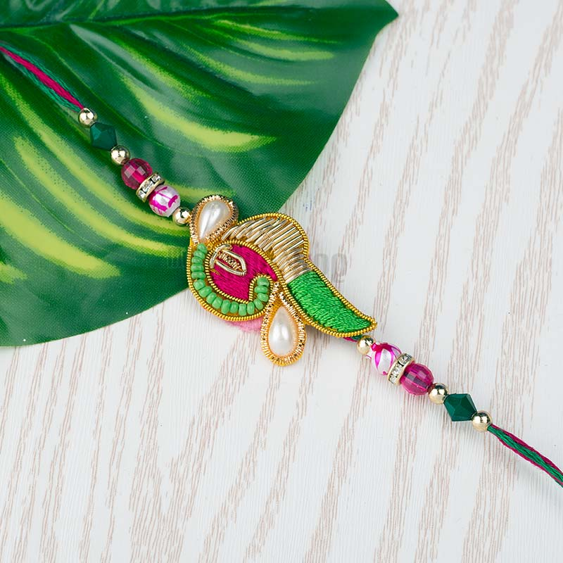Zardosi with Pearl Rakhi
