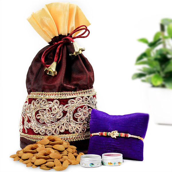 Om Rakhi and Almonds Hamper