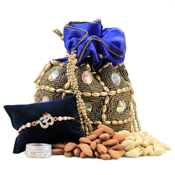Beautiful Om Rakhi and Dryfruits Hamper