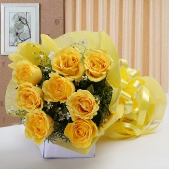 8 Yellow Roses in Paper Packing