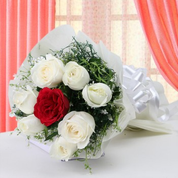 7 White Roses with 1 Red Rose in Paper Packing