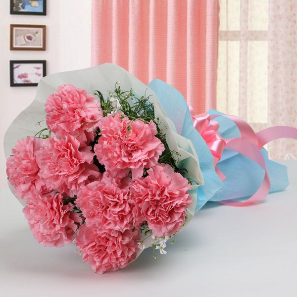 8 Pink Carnations in Paper Packing