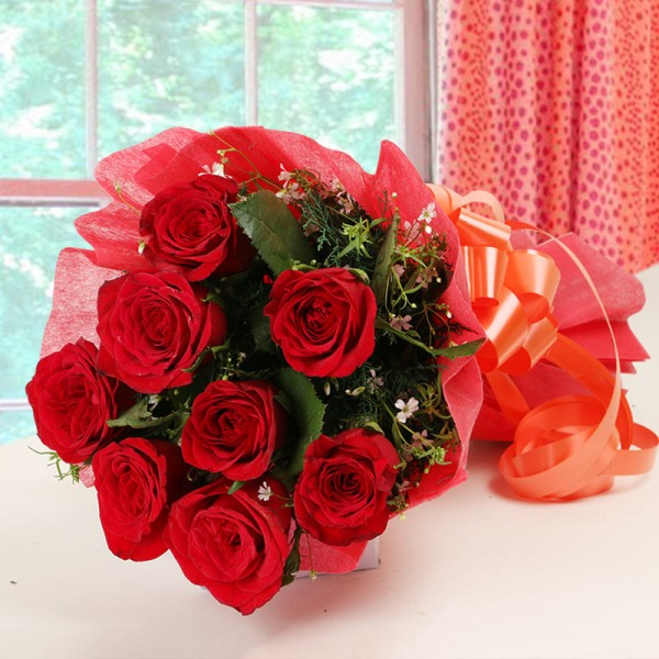 8 Red Roses in Paper Packing