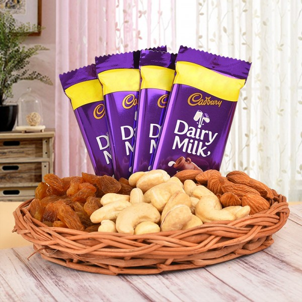 A Basket containing Almonds (100 gms), Cashew Nuts (100 gms) and Raisins (100 gms) and 4 Cadbury's Dairy Milk Chocolates (13.2 gms each)