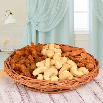 A Basket containing Almonds (100 gms), Cashew Nuts (100 gms) and Raisins (100 gms)