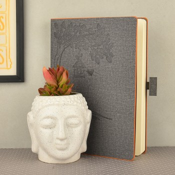 Secculent plant(Sedum rubrotinctum) in buddha head shaped vase with Grey Diary( ruled sheets, graph sheet, slips sheets inside)