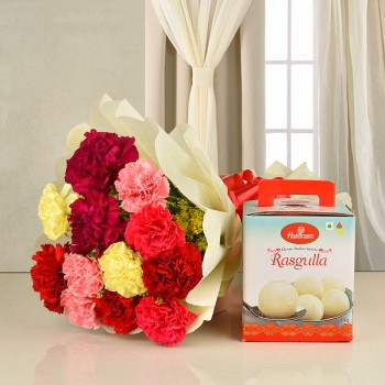 12 colorful carnations in white paper packing with 1 kg Haldiram rasgulla