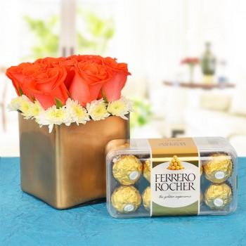 9 Orange Roses In A Special Golden Vase with 16 pcs Ferrero Rocher