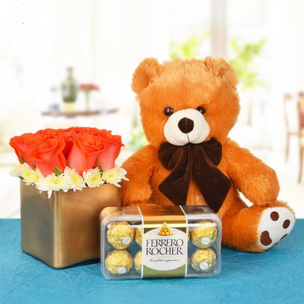 9 Orange Roses In A Special Golden Vase with 16 pcs Ferrero Rocher and 1 Teddy (10 Inches)