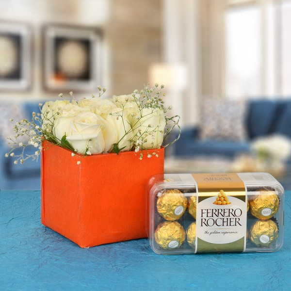 9 White Roses In A Special Orange Vase with 16 pcs Ferrero Rocher