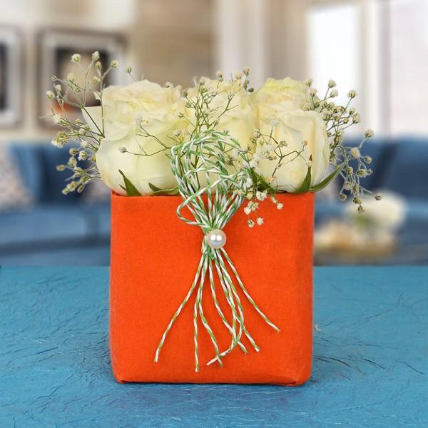 9 White Roses In A Special Orange Vase