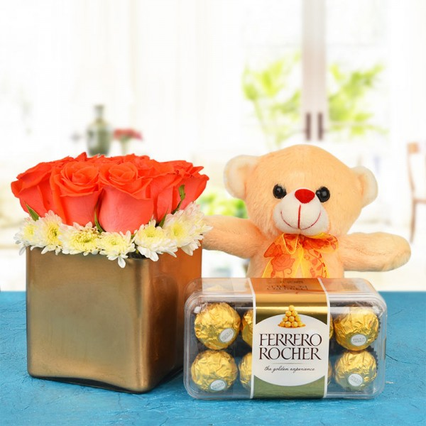 9 Red Roses In A Special Golden Vase with 16 pcs Ferrero Rocher and 1 Teddy (6 Inches)