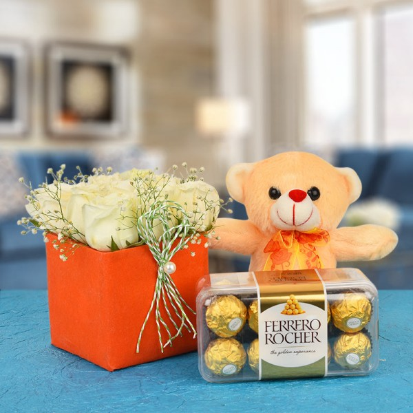9 White Roses In A Special Orange Vase with 16 pcs Ferrero Rocher and 1 Teddy (6 Inches)