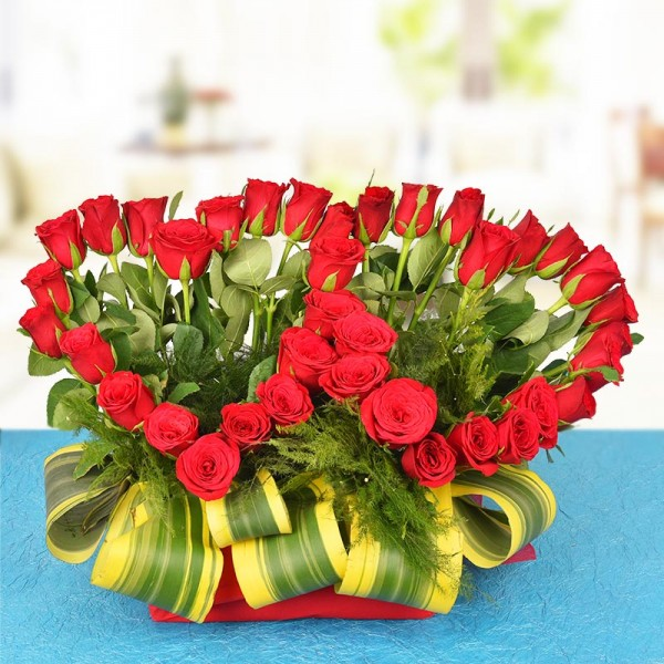 A Basket Arrangement of 40 Red Roses