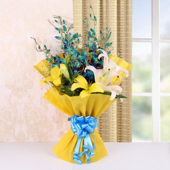 4 Blue Orchids and 4 Yellow and Pink Asiatic Lilies in Yellow Paper