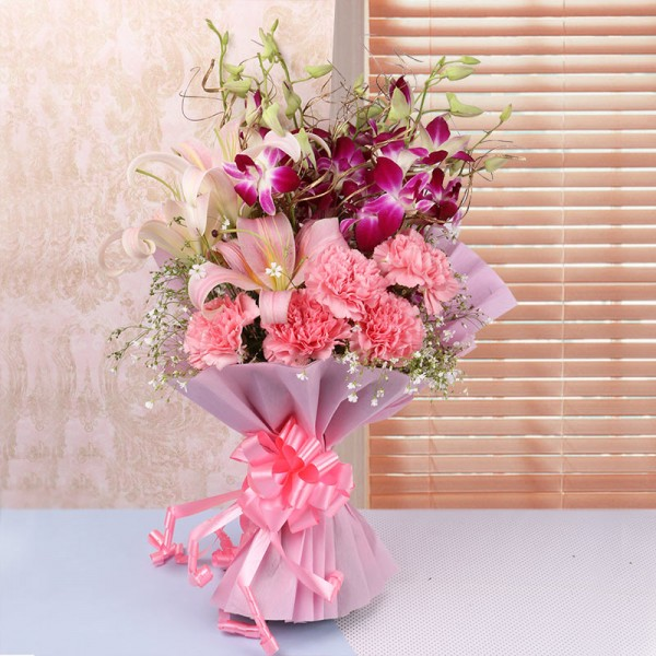 4 Purple Orchids and 4 Pink Asiatic Lilies and 5 Dark Pink Carnations in Pink paper