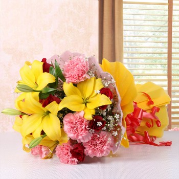5 Asiatic Yellow Lilies and 8 Red Roses and 8 Pink Carnations with Pink and Yellow Paper