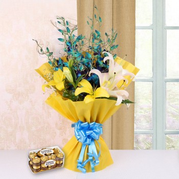 4 Blue Orchids and 4 Yellow and White Asiatic Lilies in Yellow Paper and Blue Bow with 16 pcs Ferrero Rocher
