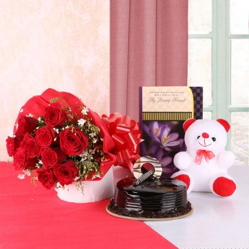 10 Red Roses in Red Paper with 1 Teddy Bear (6 inches), 1 Greeting Card and Chocolate Truffle (Half Kg)